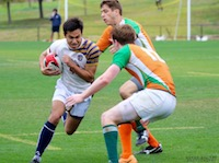 Cruz playing rugby with two of his opponents approaching.