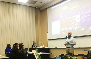Justin presenting to a group of college students.